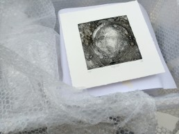 Framed and ready?! One of the small images being prepared for transportation to storage